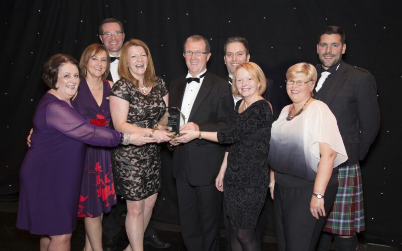Photograph of Cairn staff receiving excellence award